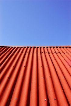 Metal roof installation on a barn