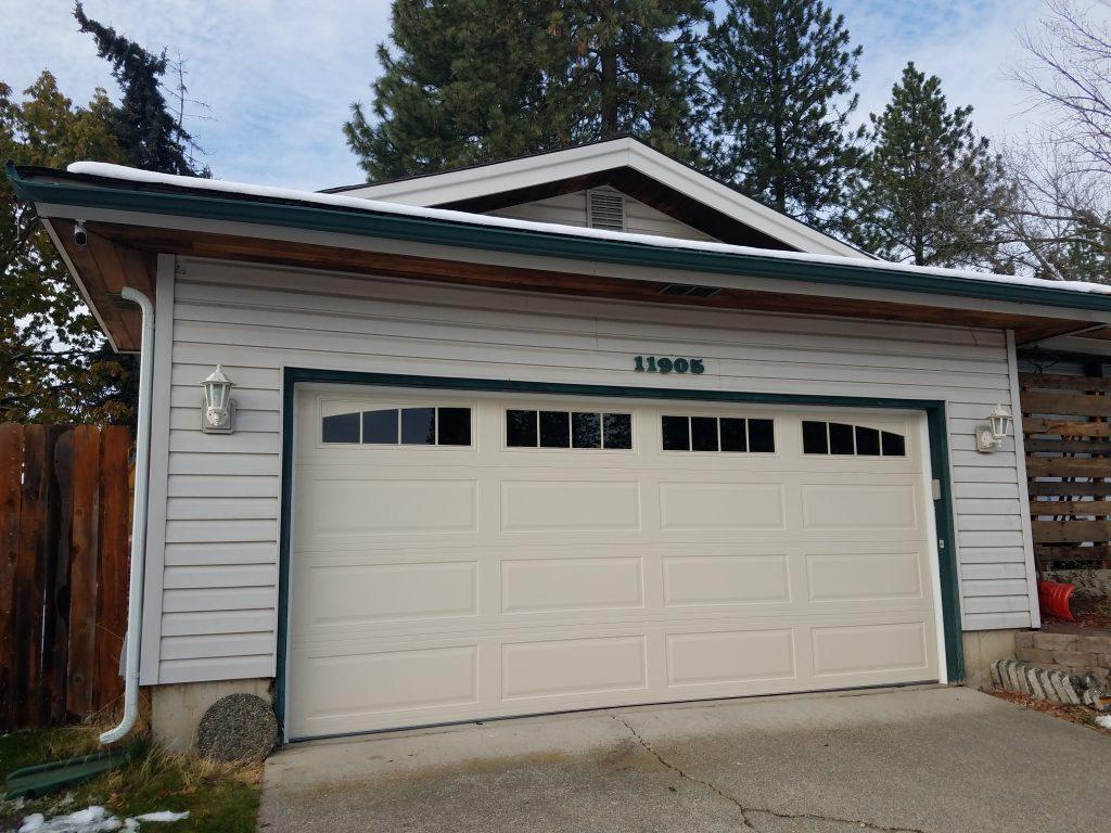 white garage with green trim